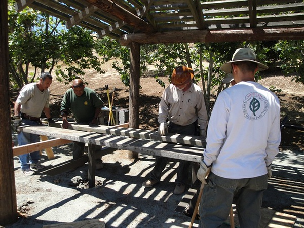 District Carpenters and Rangers work together in the construction of a park shade structure seen above.