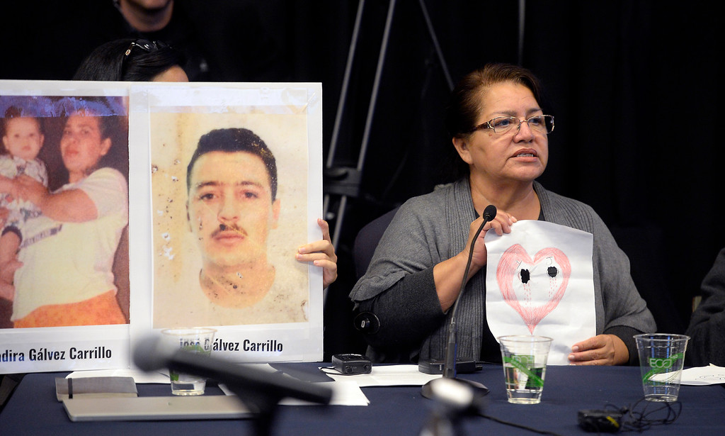 ". BOULDER, CO: October 5, 2018: Irma Carrillo holds up a drawing representing "" My Heart \""  or her lost family members at the Inter-American Commission on Human Rights which held a hearing Friday at the Colorado Law School on the University of Colorado Boulder campus to identify the remains of migrants who disappeared along the Mexico�United States border. ((Photo by Cliff Grassmick/Staff Photographer)"