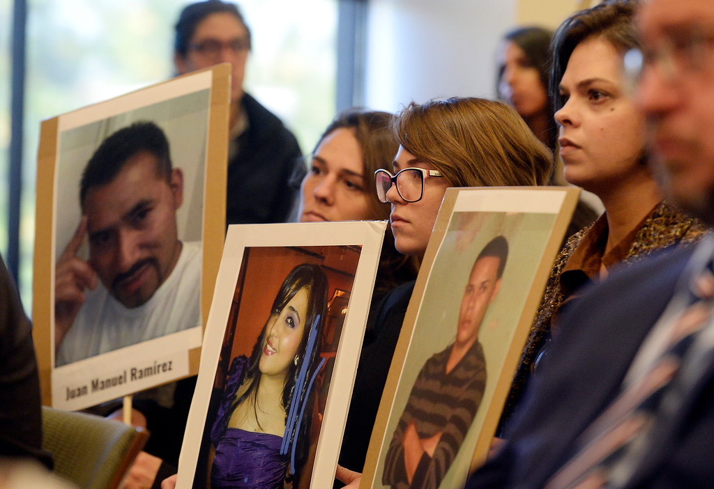 . BOULDER, CO: October 5, 2018: Many of the people in the audience held signs with photos of lost migrants. The Inter-American Commission on Human Rights held a hearing Friday on the Colorado Law School at the University of Colorado Boulder campus to identify the remains of migrants who disappeared along the United States-Mexico border, ((Photo by Cliff Grassmick/Staff Photographer)