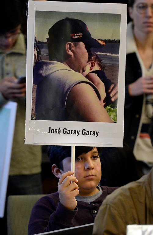 . BOULDER, CO: October 5, 2018: Andrew Norris Garay, 11, holds a sign of his father, who is lost, holding him as a baby. The Inter-American Commission on Human Rights held a hearing Friday at the Colorado Law School on the University of Colorado Boulder campus to identify the remains of migrants who disappeared along the United States-Mexico border. ((Photo by Cliff Grassmick/Staff Photographer)