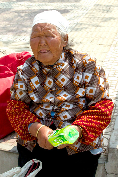 Beggar Woman at entrance to Terra Cotta Warriors Museum, Xi 'An (C) 2012