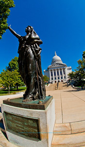 Crystal clear blue skies umbrella a replica of the 1893 Forward Wisconsin Women Memorial statue by Jean Pond Miner near the State of Wisconsin Capitol (USA WI Madison; RAO Image 6245)