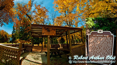 Blazing autumn hardwoods umbrella the wild Wolf River and Witman Center shelter along the legendary Old Military Road at Military Park (USA WI Lily)