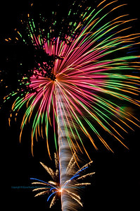 Enjoying spectacular fireworks over the village of White Lake during the fourth of July celebrations 2011 (USA WI White Lake)