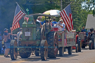 Farm tractors flags refreshments and wonderful people typify the annual Fourth of July Holiday Parade in White Lake Wisconsin (USA WI White Lake)