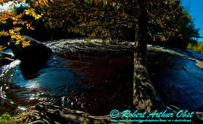 Anglers and Whitewater paddlers and hikers view during autumn of a special clear quiet place also called an eddy on the wild Wolf River at Gilmore's Mistake Rapids (USA WI White Lake)