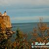 Blazing autumn foliage and bright blue skies frame cliff top Split Rock Lighthouse Minnesota State Historic Site on Lake Superior (USA MN Two Harbors; RAO 2012 Nikon D300s Image 3827)