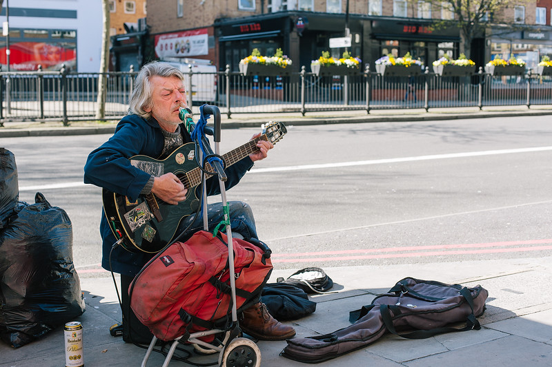 Busker sings comedic songs to any passers by.