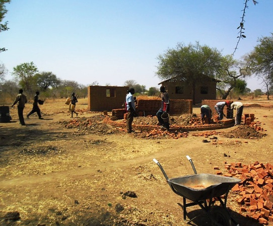 A few of the community center in the background, the kitchen, and the men's guest house. Our guest houses will be in the traditional round shape of a tukel.