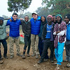 Max and Jeff Crider pose with their friendly Tanzanian porters and guides at their camp on day two of their trek to Mount Kilimanjaro.