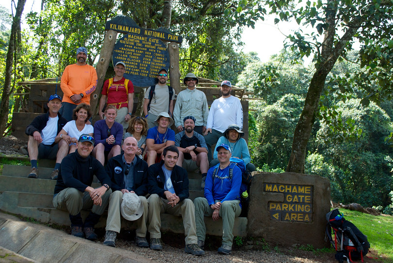 Jeff and Max Crider (front row center) pause at the Machame Gate trailhead to Mount Kilimanjaro with 14 other hikers from across the United States, including Paul Reyes (second from right in last row) and his son, Nathan Reyes (far right in second row).