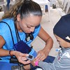 Jennifer Padilla, an Emergency Medical Technician (EMT) and Certified Phlebotomy Technician (CPT) at Eisenhower Medical Center's Emergency Department in Rancho Mirage, Calif., checks a little boy's temperature during the IMAHelps medical mission to Matagalpa, Nicaragua.