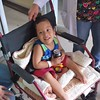 Three-year-old Jesus Montenegro smiles after receiving a wheelchair from  IMAHelps. Jesus was born with a crooked spine, a condition called Spina Bifida.