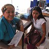 Carmen Robinson, a Registered Nurse from the Urgent Care Clinic Division at Eisenhower Medical Center in Rancho Mirage, Calif., pauses while interviewing a patient during the IMAHelps medical mission to Matagalpa.