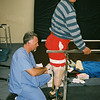 Robert Openshaw, a San Bernardino, Calif.-based prosthetist, fits Darwin Bolaños with two leg prostheses during the IMAHelps medical mission to Latacunga, Ecuador.