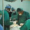 IMAHelps volunteer surgeon Mark Whyte of Pioneers Memorial Hospital in Brawley, Calif. (second from left) performs surgery on a patient with assistance from nurse Joe Gonzales (third from left), and Amanda Cuellar (left), a Family Nurse Practioner and IMAHelps volunteer from El Centro, Calif., and Rogelio Byers, an IMAHelps volunteer from Managua, Nicaragua (right).