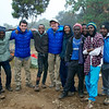 Jeff Crider, (center) and his son, Max (in matching blue jacket) pose with several Tanzanian guides during their fundraising climb up Mount Kilimanjaro for Lifewater International's water, sanitation and hygiene projects in Ethiopia.