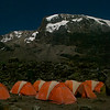 Ice glistened on the tents of the Lifewater International team as they spent a moonlit night at the base of Mount Kilimanjaro at Barranco Camp at 13,000 feet. This time released photo was taken with a tripod between 2 and 3 a.m.