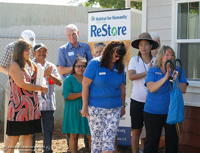 The Bruhns and Hernandez families receive keys to their new home during the Habitat for Humanity of Butte County Home Dedication Ceremony Saturday July 15, 2017 in Chico, California.  (Emily Bertolino -- Enterprise-Record)
