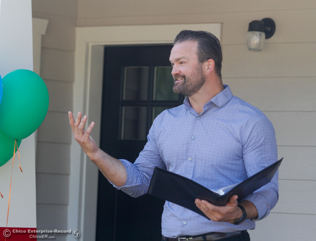 . Dan Blair with PG&E public affairs speaks during the Habitat for Humanity of Butte County Home Dedication Ceremony Saturday July 15, 2017 in Chico, California.  (Emily Bertolino -- Enterprise-Record)