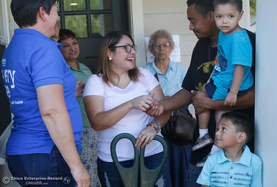 The Bruhns family cuts down the celebratory ribbon and receives the keys to their new home during the Habitat for Humanity of Butte County Home Dedication Ceremony Saturday July 15, 2017 in Chico, California.  (Emily Bertolino -- Enterprise-Record)