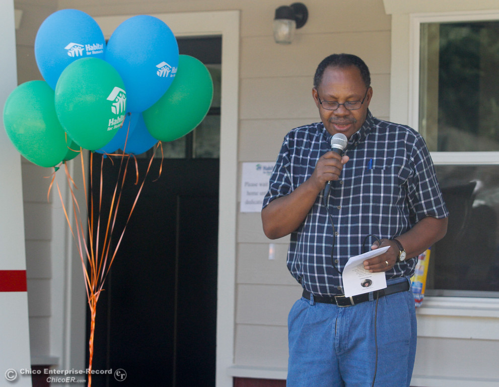 . Pastor Joseph Kiwovele from Second Baptist Church says the opening prayer during the Habitat for Humanity of Butte County Home Dedication Ceremony Saturday July 15, 2017 in Chico, California.  (Emily Bertolino -- Enterprise-Record)
