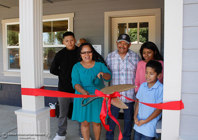 The Hernandez family cuts down the celebratory ribbon and receives the keys to their new home during the Habitat for Humanity of Butte County Home Dedication Ceremony Saturday July 15, 2017 in Chico, California.  (Emily Bertolino -- Enterprise-Record)