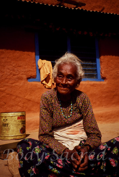 Namaste  <br /> Nepal, 1990                                                             <br /> The kindness, joy and love in this Nepali Grandmother eyes reflect back to us the divine spark within ourselves .  Her large hands cradle the spark of our spirit.