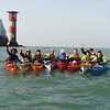Big 5 kayak challenge team at the Needles, isle of Wight.<br /> L to R - Dean Buckingham, Rob Bates, Richard H, Aisling Ni Chuinn, Helen Reeves, David Gordon, Aaron Buckingham, Geoff Tilford, David McCarthy