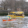 Rich kayaking past the Duck on the Thames outside Westminster