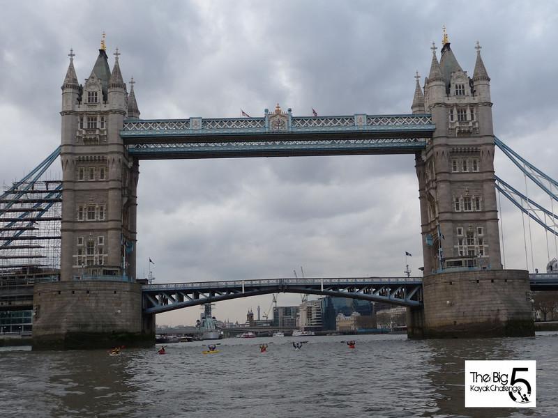 The Big 5 kayak challenge team paddle under Tower Bridge , Feb 2009