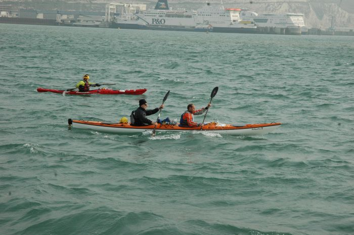Leaving Dover Harbour for the crossing, Geoff and Owen in the double and David Gordon in the single