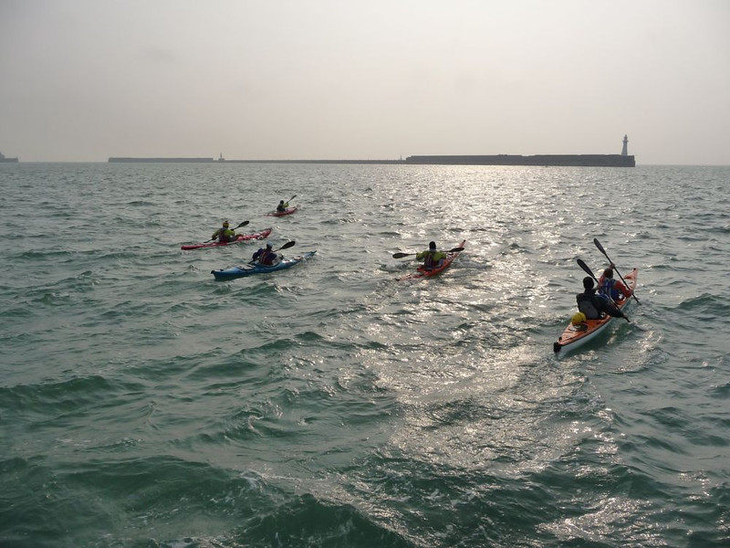 Our intrepid sea kayakers heading out of Dover Harbour to sea kayak the Channel despite it being a Force 4 and given to increase to a Force 5.