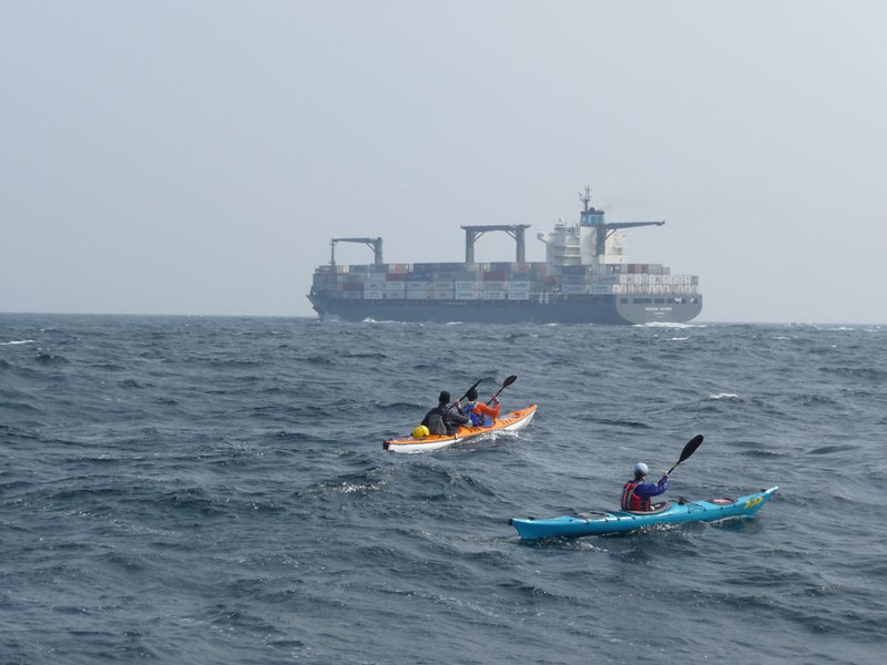 Crossing the busiest shipping lane in the world by kayak.