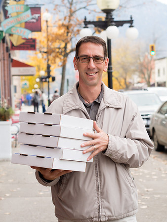 """""""Excuse me. I see you're in a hurry, but can I take your photo?""""<br /> <br /> """"I am in a hurry, I've got hot pizza's here. But ok, you can take my photo."""""""