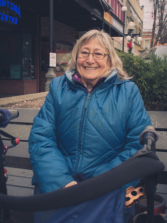 """""""I live alone. So I love to be out. I can sit and read my book, but also have visits with old friends as they walk by. This is my favourite bench cause it faces the sun. I crave sun light."""""""