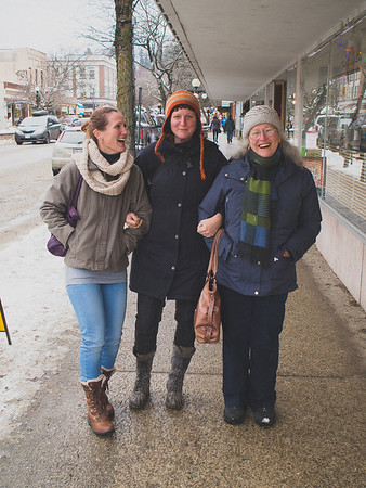 "These lovely ladies were walking down the street, arm-in-arm with big smiles on their faces. Despite how it might look, I did not pose them one bit.<br /> <br /> And our conversation lasted 12 seconds...<br /> <br /> Sans Touque: ""This is my mom, and my sister.""<br /> <br /> Me: ""And that must make you the centre of the universe.""<br /> <br /> Grey Touque: ""That's about right!"""