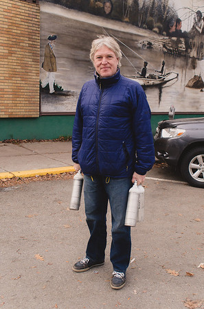 """""""The oxygen tanks are for my father-in-law.""""<br /> <br /> """"What's the most difficult thing about taking care of someone?""""<br /> <br /> """"My wife past away last year. We took care of him together. And now it's just me.""""<br /> <br /> """"Is it ok if I write that story as a caption to the photo?""""<br /> <br /> """"Sure. That's ok."""""""