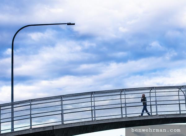 Man walking on overpass
