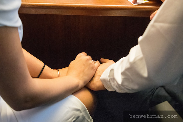 Holding hands under table