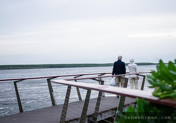 Senior citizens looking at ocean