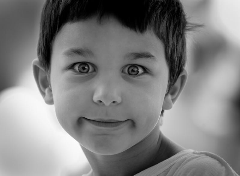 Mystical eyes, a boy in a crowd