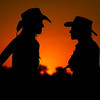 Cowgirls at sunset