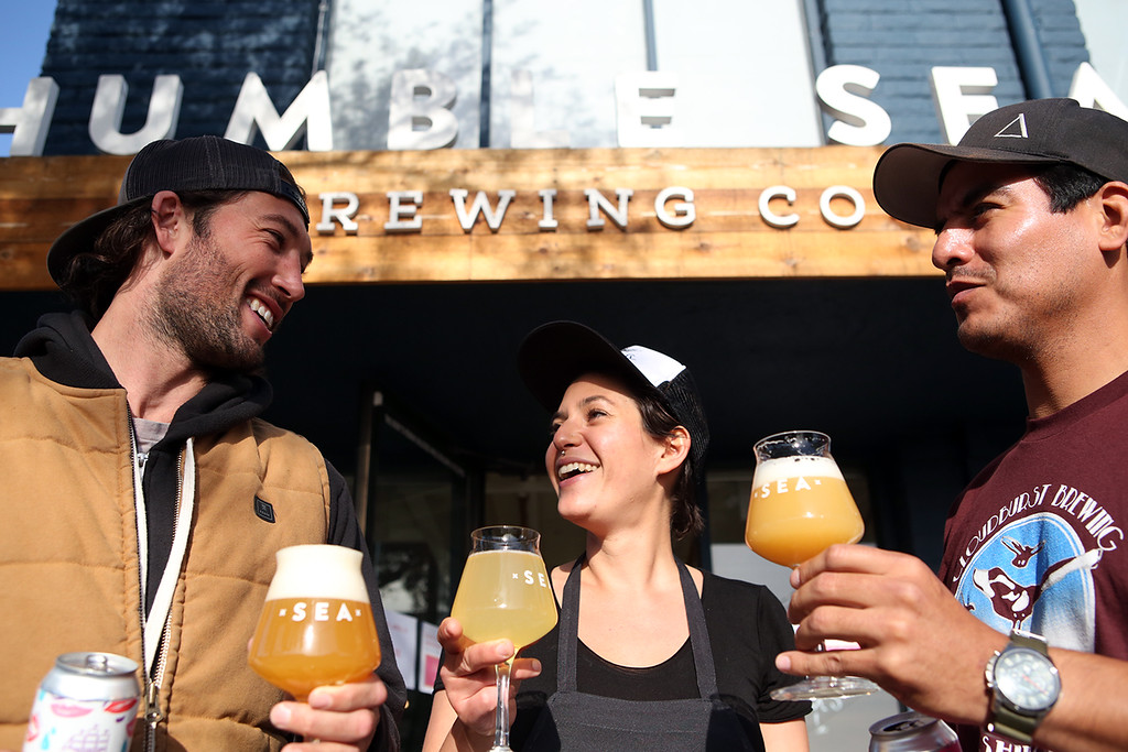 . Humble Sea Brewing Company Co-Founder Taylor West, Food Program Director Julia Tonkin and Director of Beer Logistics Nick Sanchez. (Shmuel Thaler -- Santa Cruz Sentinel)