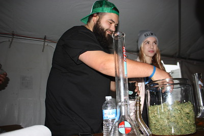 Josh, who preferred not to give his last name, packs a free sample bag of The Dookie Brothers' award-winning strain Zkittles during the Humboldt County Cup in Redway on Saturday. (Will Houston - The Times-Standard)