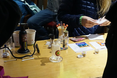 Smoking paraphernalia sit on a table to make sampling product possible.  Water pipes set up for samples at the Graham's Brand booth during the Humboldt County Cup in Redway on Saturday, Jan 21. (Kellie Ann Benz - The Redwood Times)