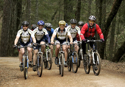 President George W. Bush rides with the Travis Air Force Base cycling team at the Los Posados State Forest, in St. Helena, California, Saturday, April 22, 2006 White House Photo by Eric Draper