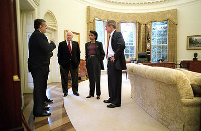 President George W. Bush meets with Vice President Dick Cheney, CIA Director George Tenet and National Security Advisor Condoleezza Rice in the Oval Office after informing the nation that air strikes were made against the Taliban Sunday, October 7, 2001 WHITE HOUSE PHOTO BY ERIC DRAPER