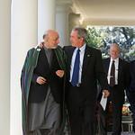 President Bush: walks with Afghan President Hamid Karzai through Colonnade