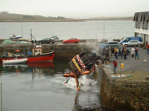 Towtruck plunging into the drink
